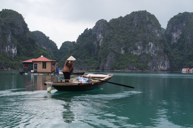 Local rowing to her floating home in Halong Bay