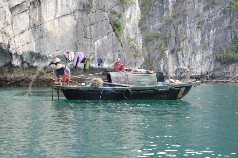 Locals casting their nets in Halong Bay