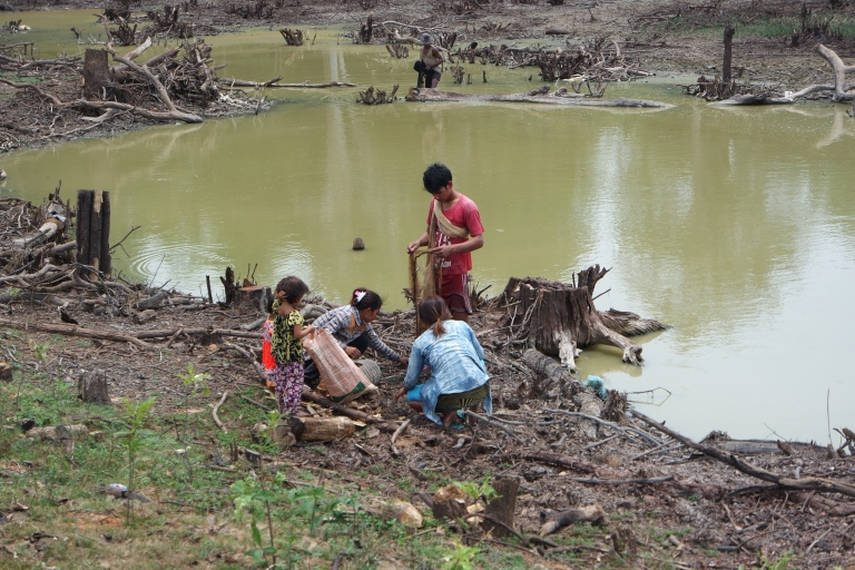 Not all at Angkor Wat is beautiful. The poverty is clear here where locals fish in a polluted dried out pond.